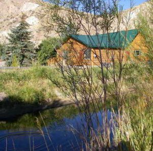 Montana Fly Fishing lodge with rising trout in creek