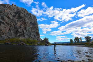 Fisherman near the big rock on the Big Hole River