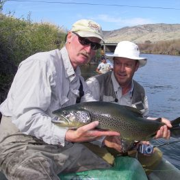 Guide holding large brown trout on the beaverhead river