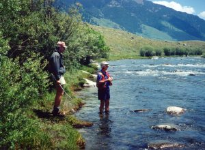 Madison river guide waiting to net fish
