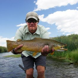 guide Andy Bennett holding large beaverhead brown trout