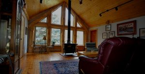 Montan Fly Fishing Lodge interior with wood stove